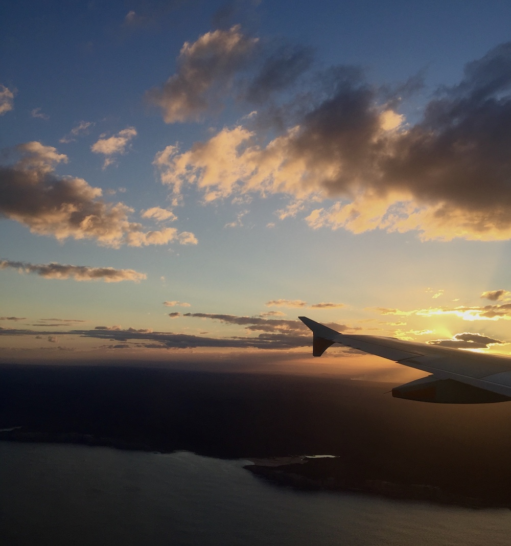 View of sunlit sky from plane. Photo.
